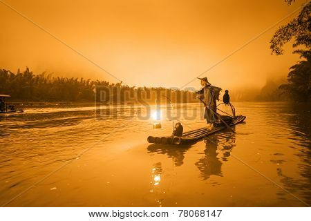 Traditional Chinese cormorant fisherman on the Li River in Yangshuo, China.