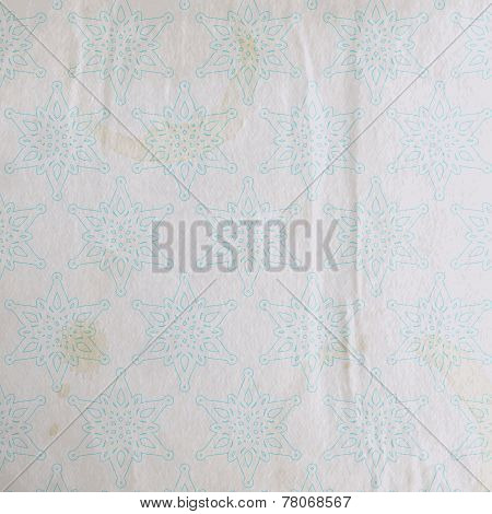 vector vintage christmas background with snowflakes and old wrinkled paper texture