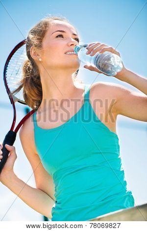 Pretty Sportswoman With Racket On Shoulders