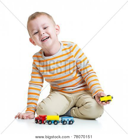 Kid boy playing with train toy