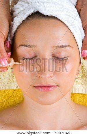 Applying Serum To Woman Eyes Skin