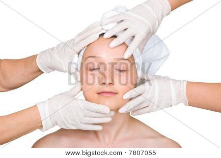 Woman Face In Rubber Hands Of Doctors