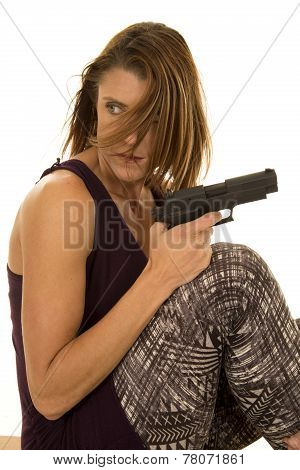 Woman In Tank Top Sit With Gun Hair In Face Look Back