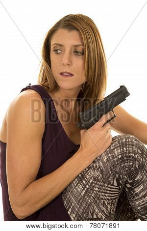 Woman In Tank Top Sit With Gun Look Back