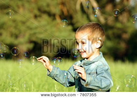 Little Boy Plays With Bubbles