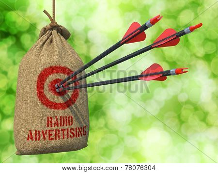 Radio Advertising - Arrows Hit in Red Target.