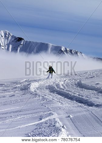 Snowboarder Downhill On Off-piste Slope In Sunny Day