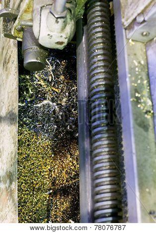 Metal Turnings In Sump Of Lathe Machine