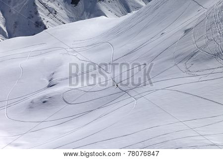 Top View On Snowy Off Piste Slope With Trace From Ski And Snowbo