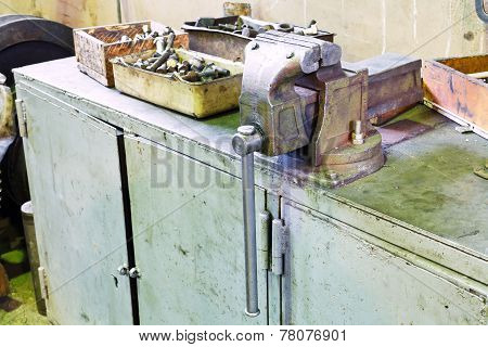 Vice On Table In Locksmith Workshop