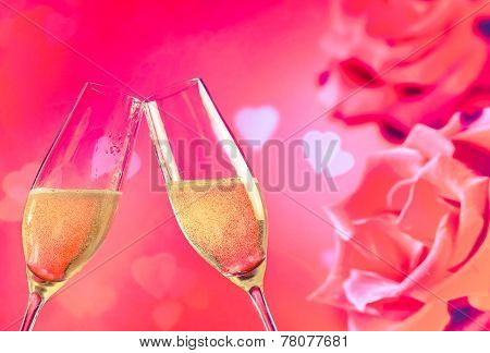 Champagne Flutes With Golden Bubbles On Roses Flowers Background