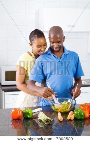 loving couple making salad