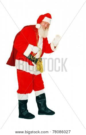 Modern Santa Claus holds his Bag of presents as he waves. Isolated on white with room for your text. Santa Claus is a mythical figure some say, others believe in Santa Clause and say they saw him.