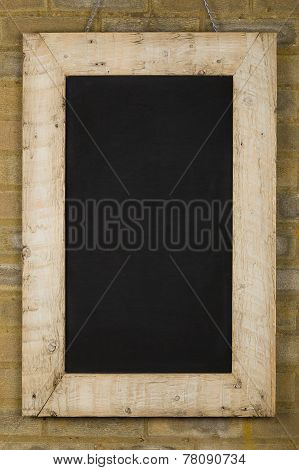 Vintage Chalkboard Reclaimed Wood Frame On Brick Wall
