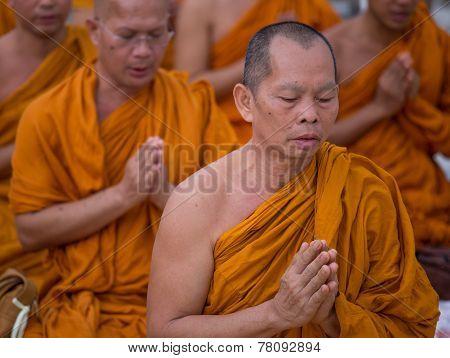 Yangon, Myanmar - November 22, 2014: Several Unidentified Buddhist Monks Pray At Shwedagon Pagoda