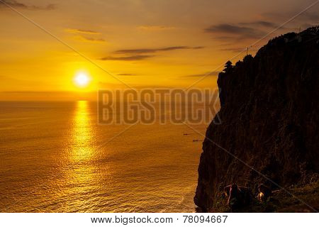Sunset At A Cliff In Bali Indonesia.