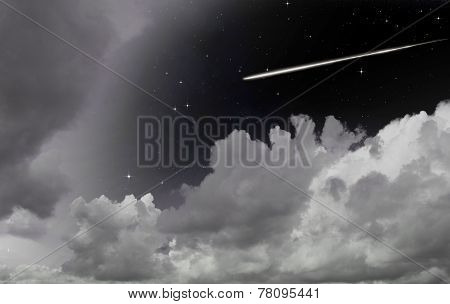 A Shooting Star Between Clouds