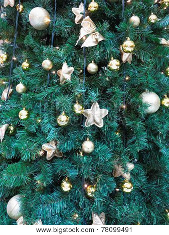 Abstract Christmas Background With Golden Balls And Stars