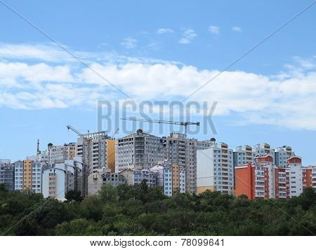 Residential Modern Apartment House, Green Forest And Blue Sky