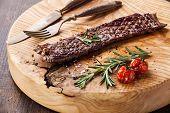 stock photo of machete  - Steak Machete with rosemary salt and pepper on wooden background - JPG