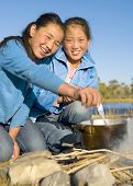 stock photo of mongolian  - Beautiful Mongolian girls anjoy camping - JPG
