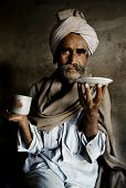stock photo of rajasthani  - Portrait of a Rajasthani Indian man at an early morning market - JPG