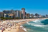 stock photo of ipanema  - Crowded Ipanema and Leblon Beaches on Clear Sunny Summer Day - JPG