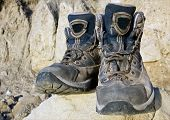 foto of welts  - Tourists boots on stone in mountains  - JPG