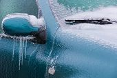 picture of wiper  - Frozen rearview mirror and wiper of the car with icicles ice and frost - JPG