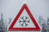 stock photo of icy road  - Traffic sign for icy road covered with ice - JPG