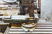 pic of locksmith  - vice and drill of old boring machine close up in locksmith workshop - JPG
