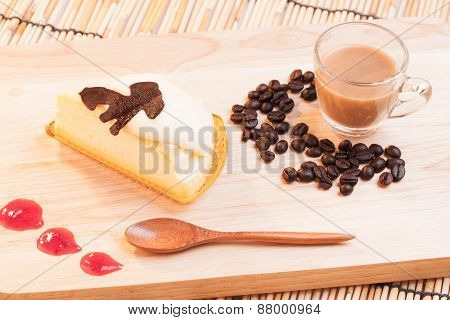 Cheese Custard Cake And Cup Of Coffee On Wood.