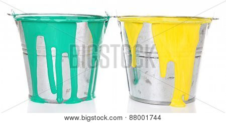 Buckets of paints isolated on white
