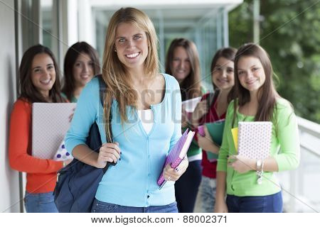 Smiling teenagers with exercise books