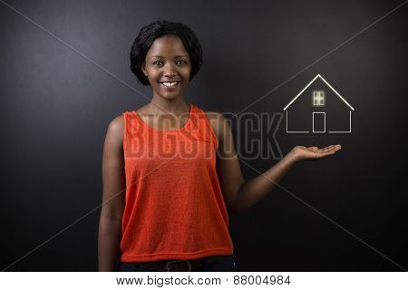 South African Or African American Woman Teacher Or Student Against Black Background With Home House