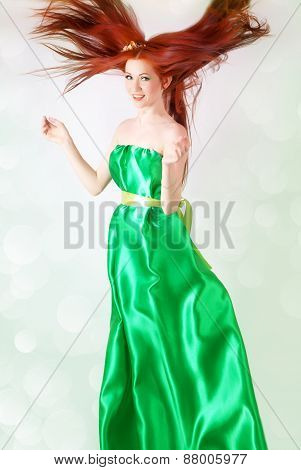 Red-haired Girl In A Green Dress With Flowing Hair
