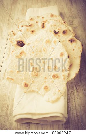 Vintage Photo Of Homemade Whole Wheat Flour Tortillas On A Wooden Table. Unleavened Bread.