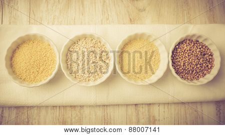 Types Of Grain Groats On A White Wood. Vintage Photo