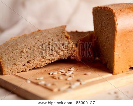 Sliced Dark Bread With Crumbs On Sacking Background