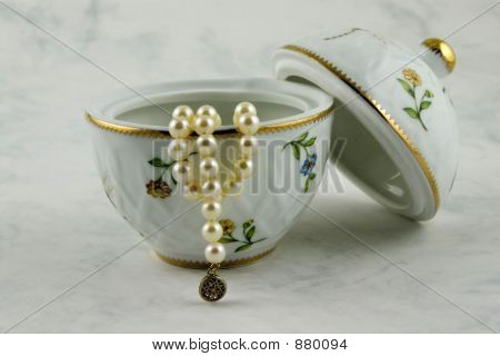 Treasure - Pearls Necklace And China Vase On White Background