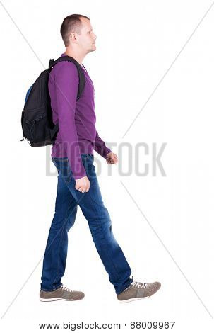 back view of walking  man  with backpack.  backside view of person.  Rear view people collection. Isolated over white background. young man goes to side of a rolling travel bag on wheels