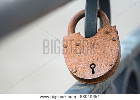 Big Rusty Padlock On Fence