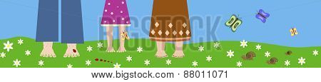 People stand barefoot on the grass