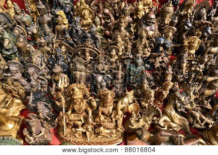Collection Of Buddhist And Hindu God Statuettes