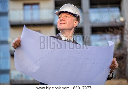 Construction manager with blueprints