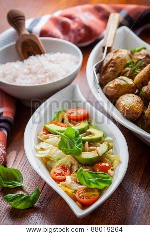 Low calorie cabbage salad with avocado and oven potatoes