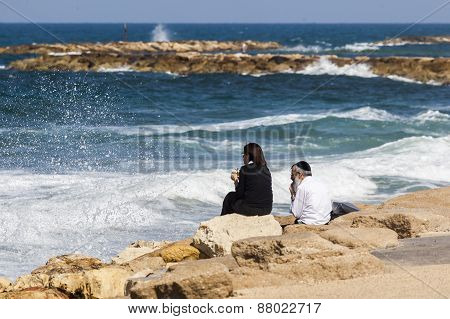Couple At The Seashore Enjoys The View. Tel Aviv, Israel