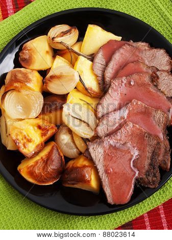 Roasted Pork With Baked Potatos