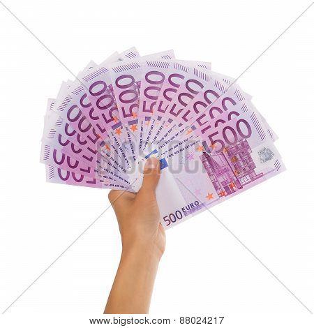Female Hand Holding Pile Of Euro