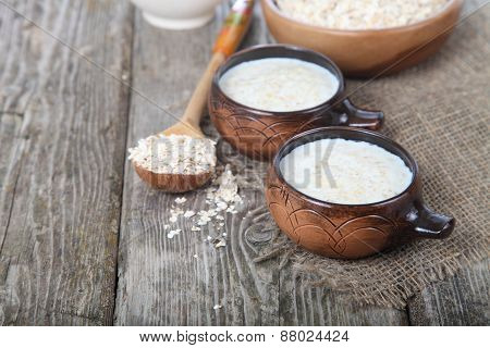 Oatmeal On Old Wooden Table